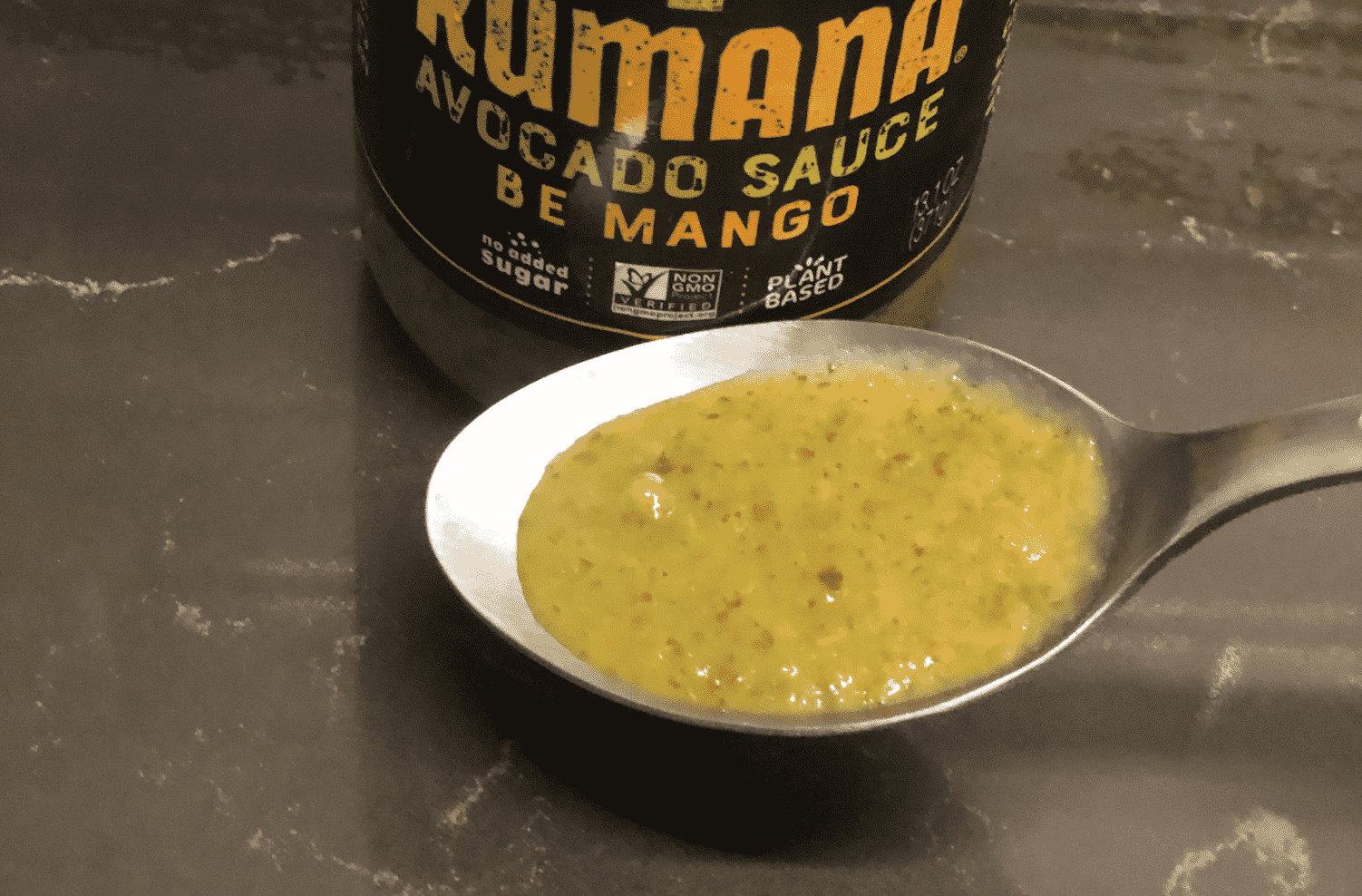 Kumana Avocado Sauce Be Mango on spoon