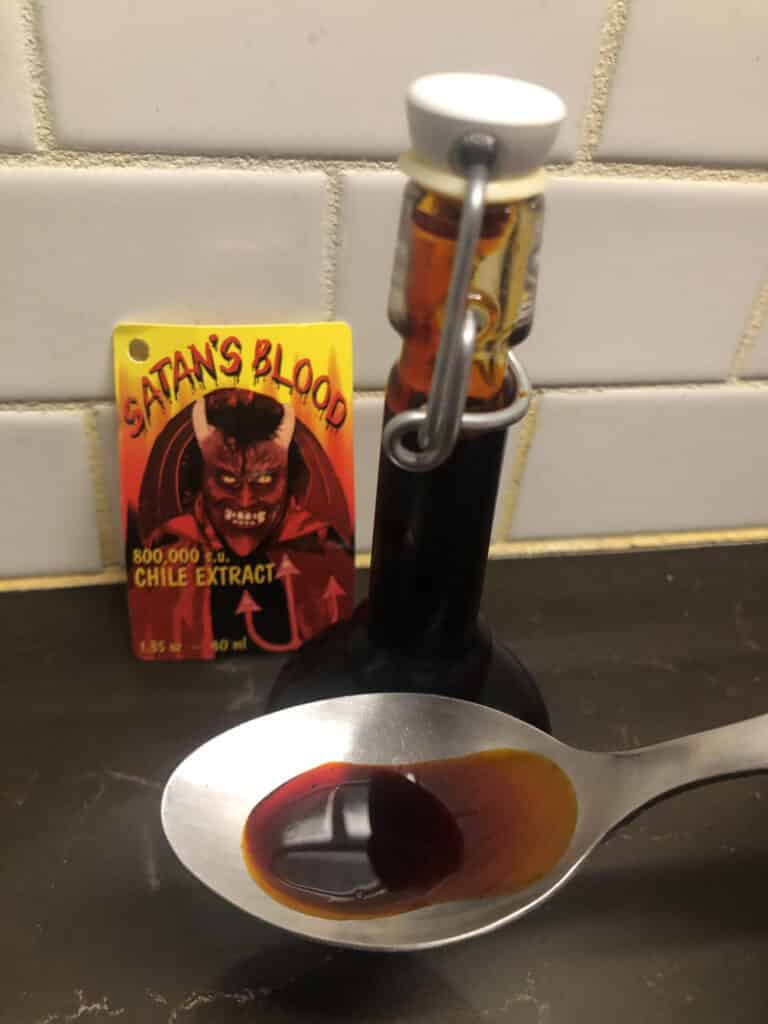 Satan's Blood Hot Sauce in spoon
