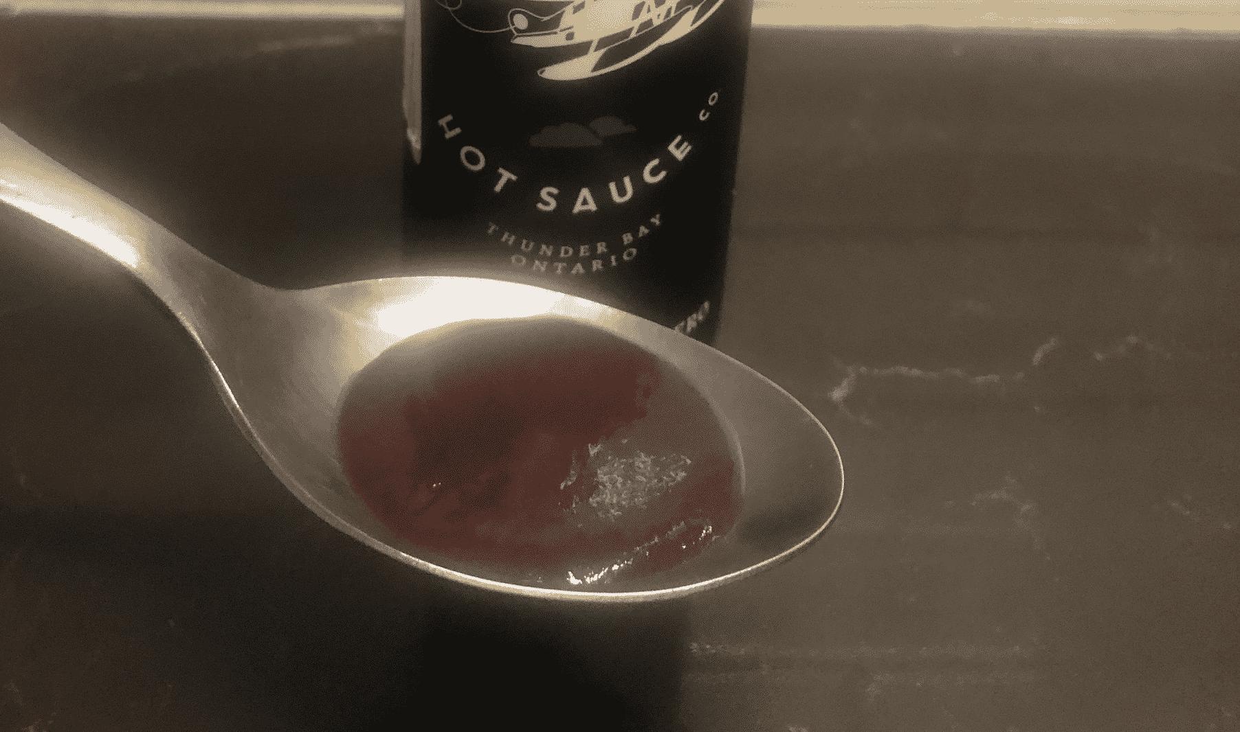 Heartbeat Blueberry Habanero Sauce in spoon