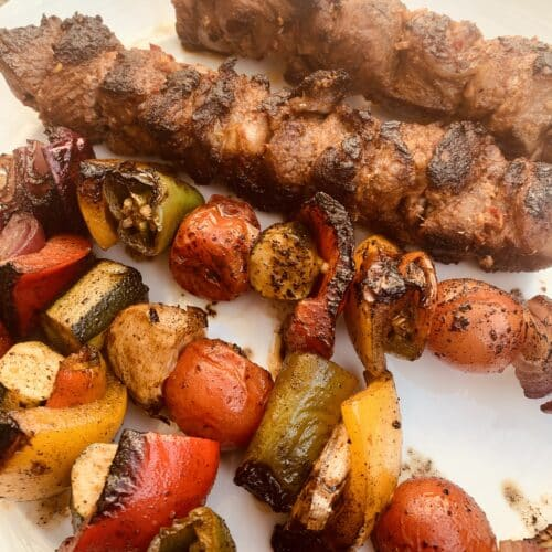 Spicy lamb kabobs with vegetable skewers - cooked