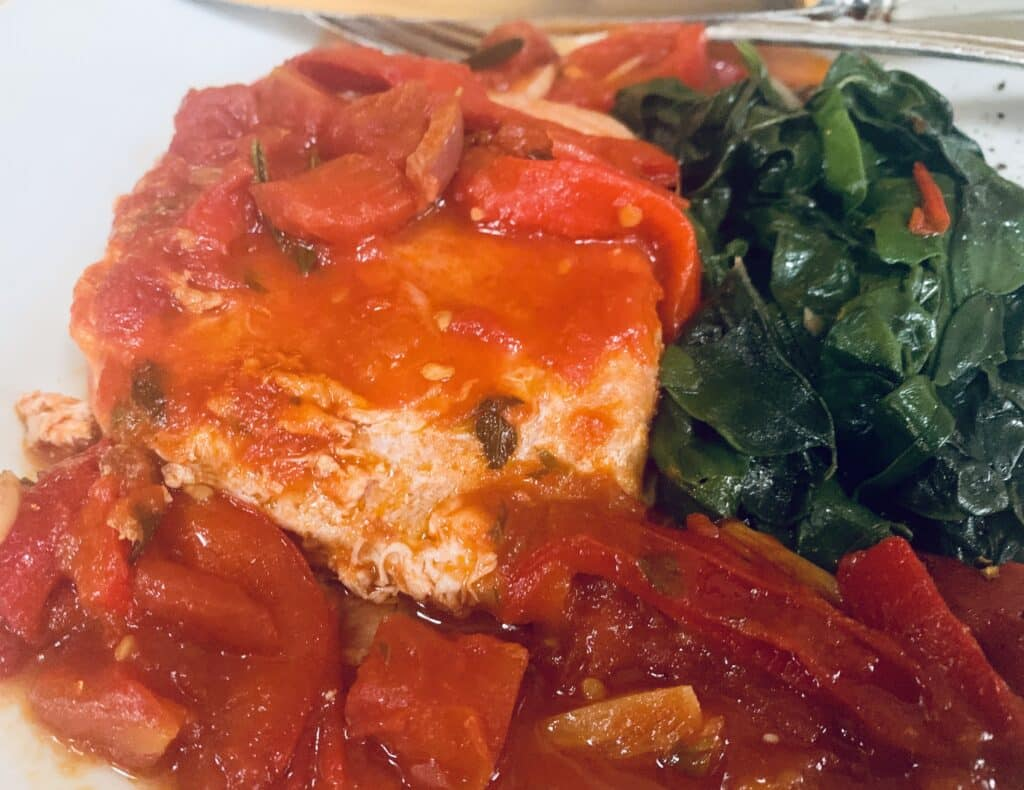 Sicilian tuna steaks with spicy sauce and garlic spinach