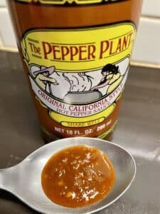 The Pepper Plant Hot Sauce on a spoon