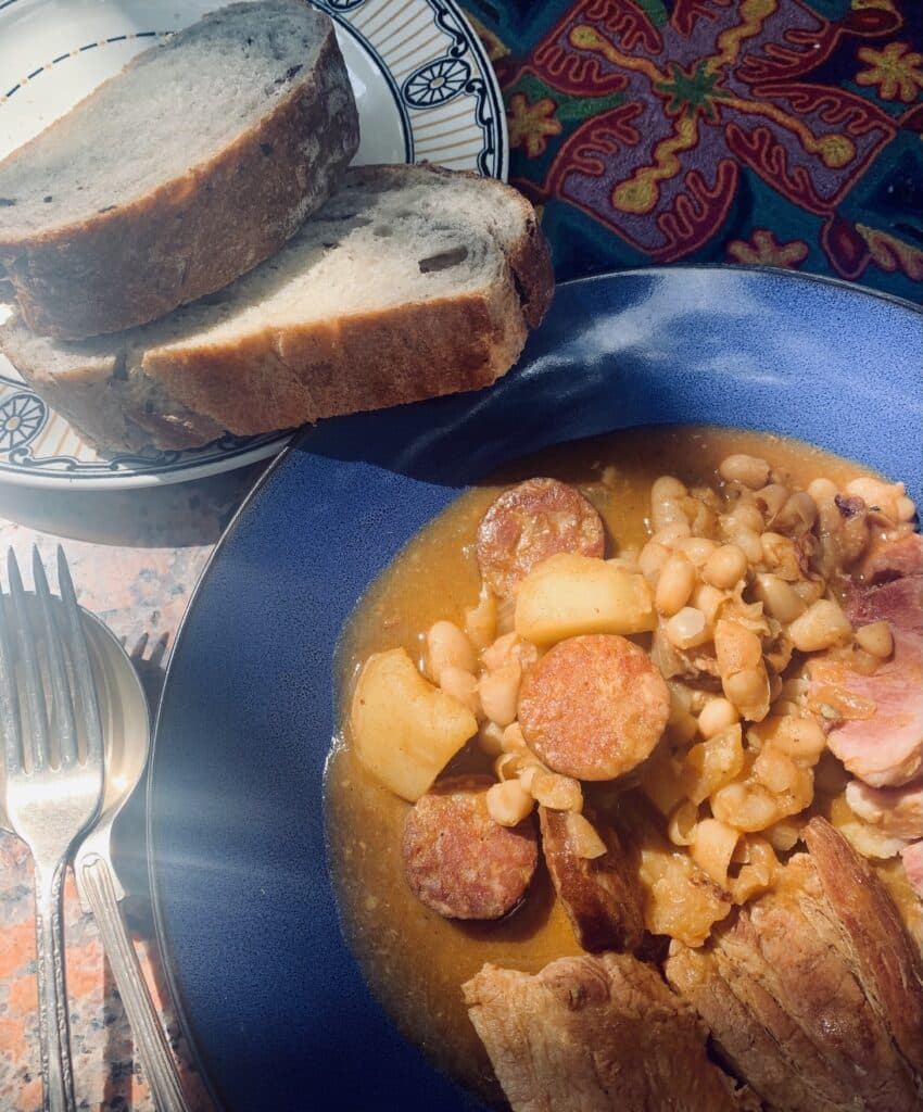 Fabada-style pork and beans with a side of crusty bread