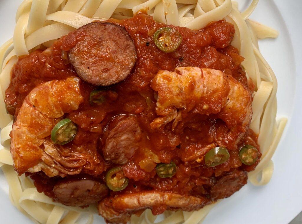 Chorizo and shrimp fettuccine with pomodoro sauce close up