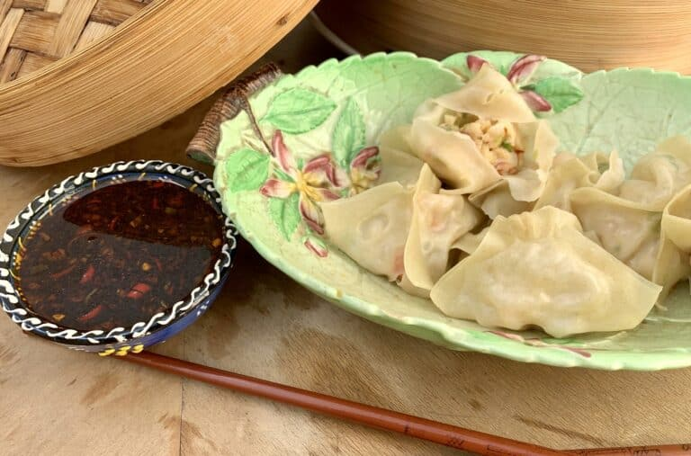 Steamed shrimp dumplings with fiery dipping sauce