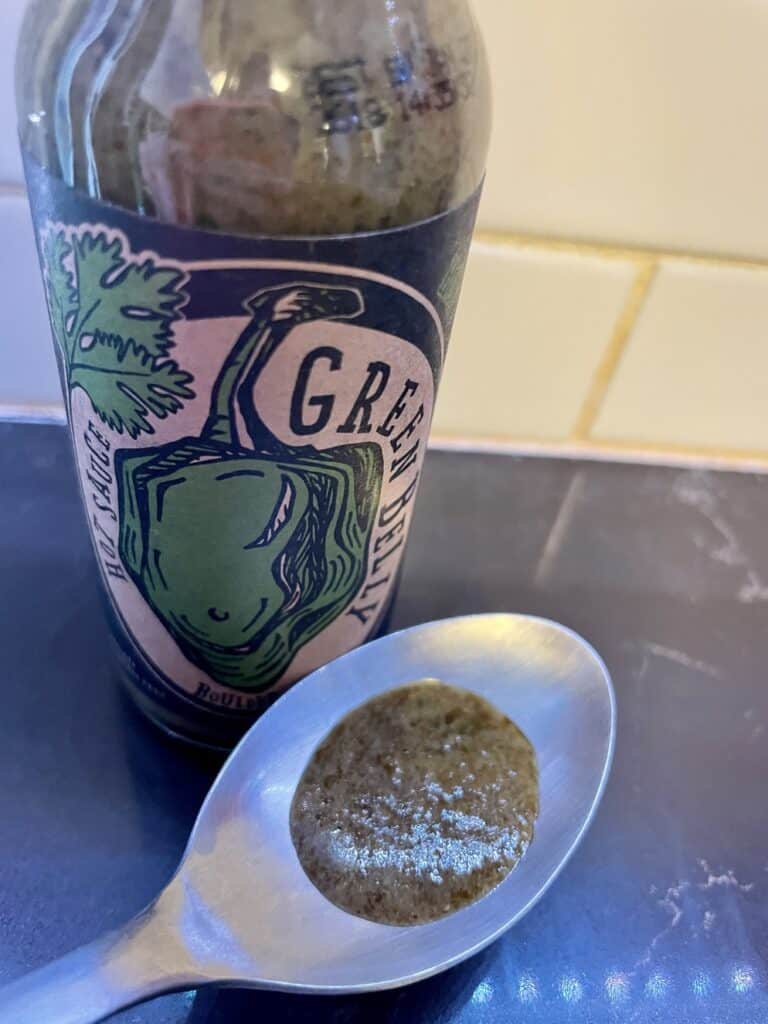 Green Belly Hot Sauce on a spoon